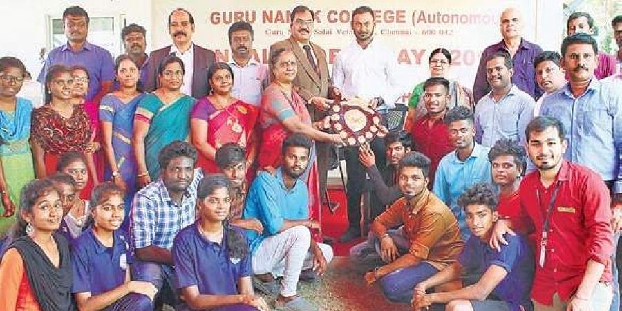 Cricketer and alumnus of Guru Nanak college, Arun Karthik, with winners and staff during the sports day celebrations at the college    Nakshatra Krishna-moorthy