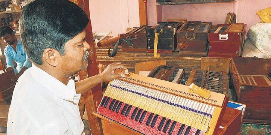 Ashok Koni hard at work making a harmonium in his house at Jantli-Shirur village in Gadag    D Hemanth