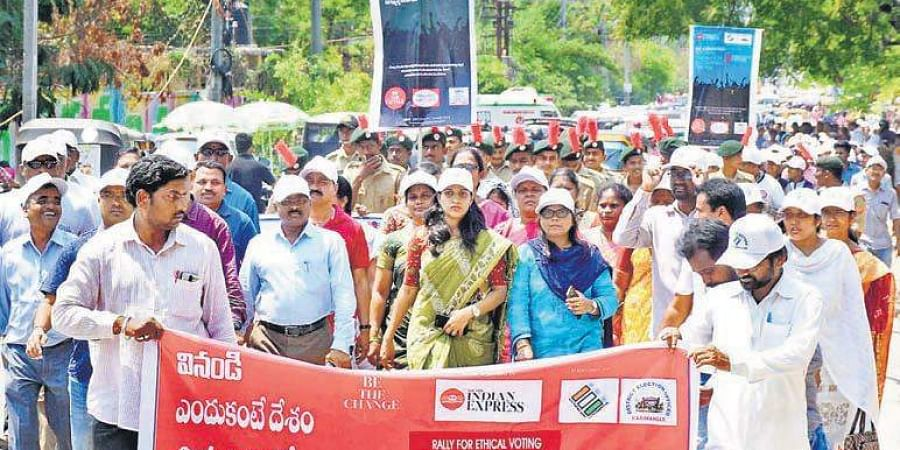Election Special Officer P Praveenya (centre) walks beside Municipal Commissioner of Karimnagar K Satyanarayana at the Rally for Ethical Voting, in Karimnagar on Saturday.