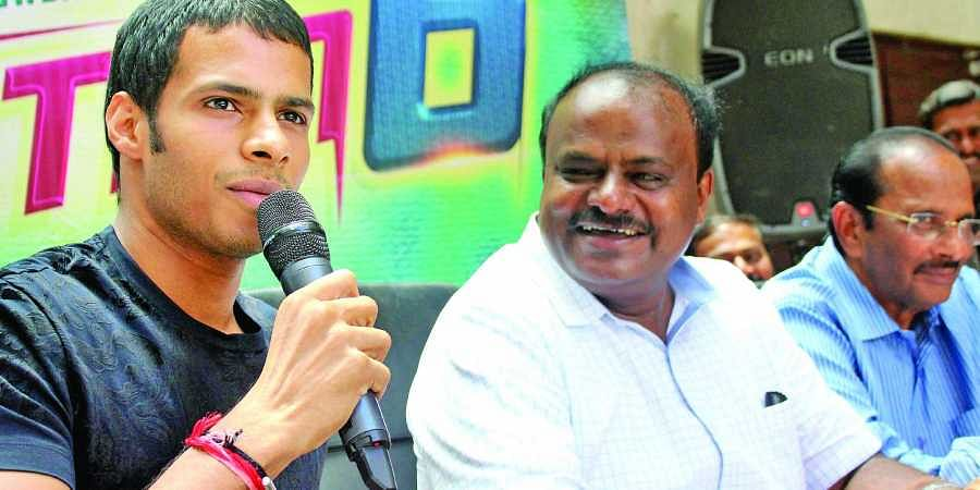 JD(S) leader HD Kumaraswamy with his son Nikhil Gowda
