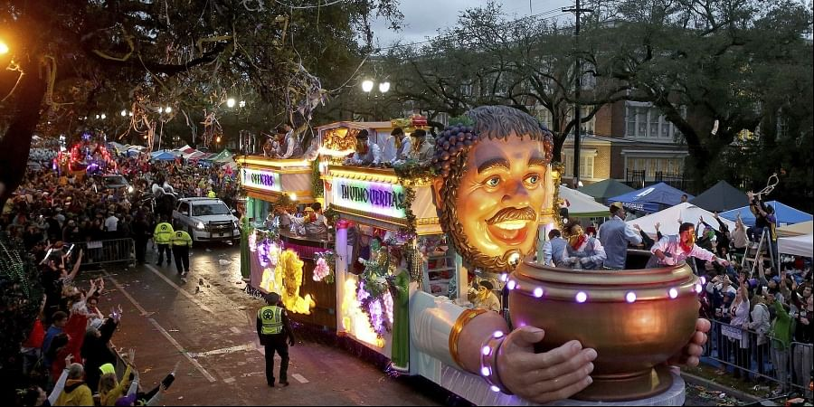 The Officer's Float rolls down Napoleon Avenue as the 1,600 men of Bacchus present their 32-float Mardi Gras parade entitled 'Starring Louisiana' on the Uptown route in New Orleans. (Photo | AP)