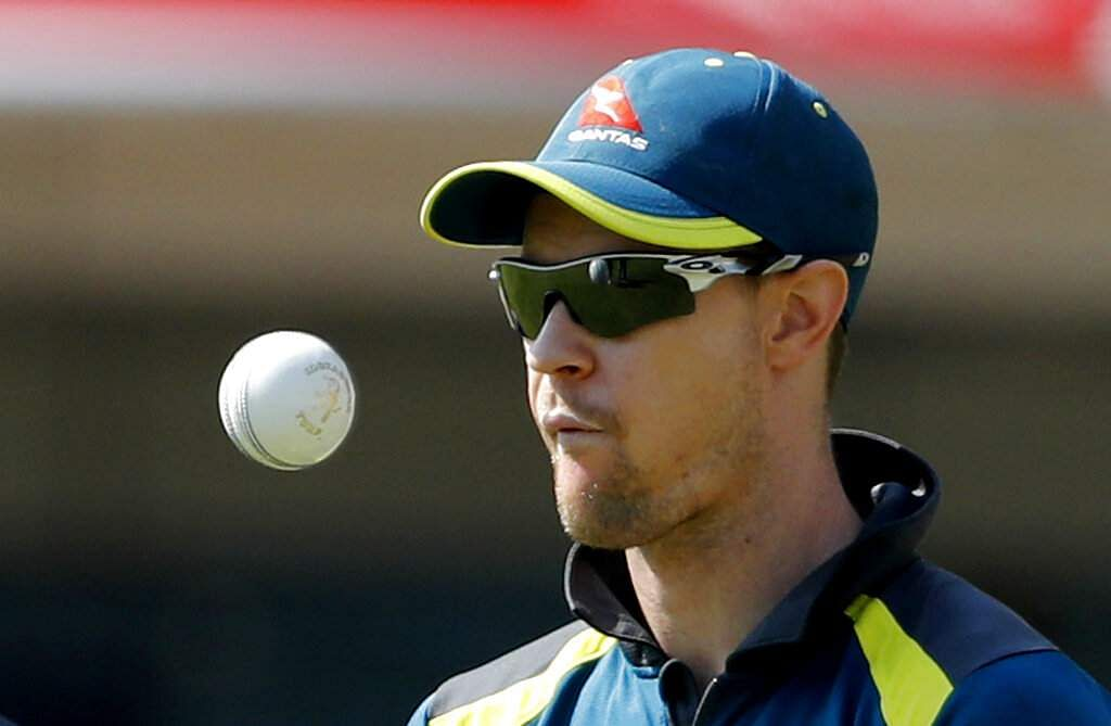 Australia's Jason Behrenderoff tosses a ball in the air during a training session  ahead of their third ODI match against India in Ranchi.