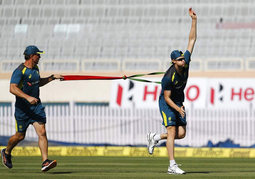 Australia's Jason Behrenderoff, right, performs stretching exercises during a training session ahead of their third ODI match against India in Ranchi. | AP