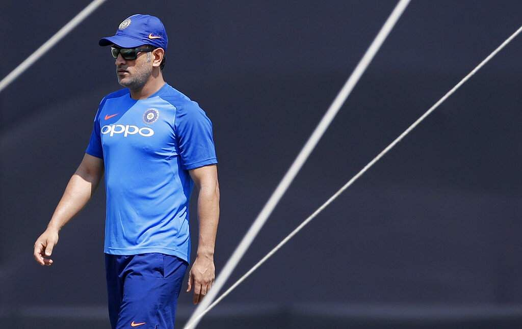 India's MS Dhoni walks to inspect the pitch before batting in the nets during a training session ahead of their third ODI match against Australia in Ranchi.