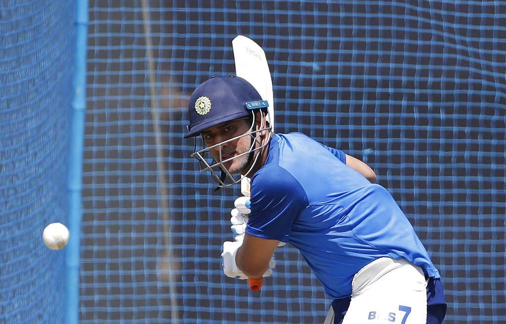 India's MS Dhoni bats in the nets during a training session ahead of their third one day international cricket match against Australia in Ranchi.
