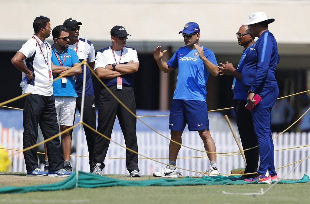 MS Dhoni interacts with officials after inspecting the pitch area during a training session ahead of their third ODI match against Australia in Ranchi.