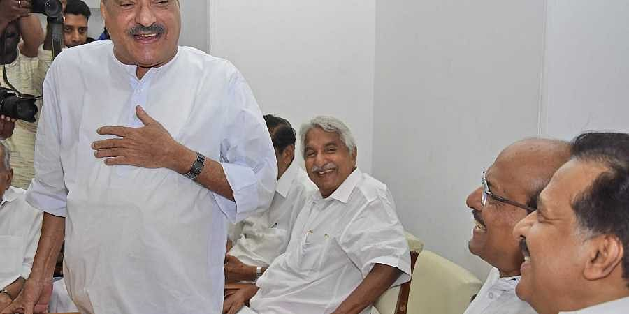 Opposition leader Ramesh Chennithala, Muslim League national general secretary PK Kunhalikutty and former chief minister Oommen Chandy are all smiles when Kerala Congress leader KM Mani, after his return to the United Front, speaks at the UDF meeting at C