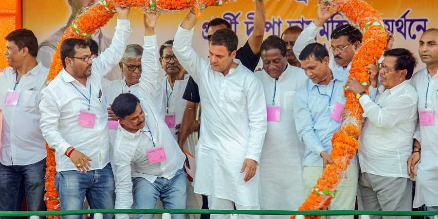 Congress President Rahul Gandhi being garlanded during an election campaign rally in North Dinajpur district of West Bengal. (Photo | PTI)