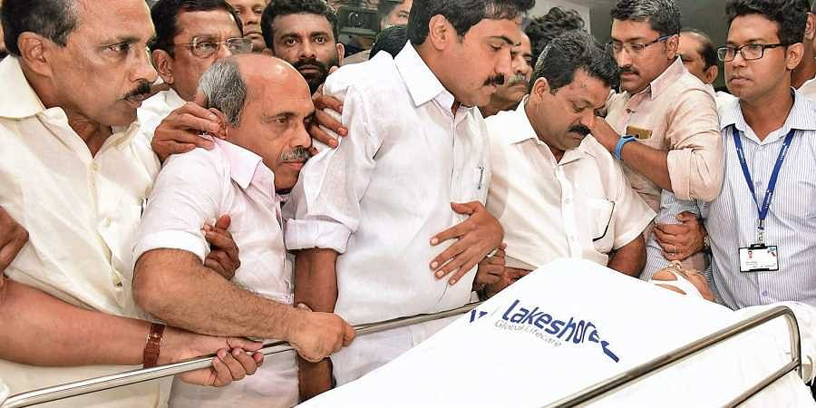 Jose K Mani along with UDF leaders paying homage to K M Mani when his body was kept at VPS Lakeshore Hospital on Tuesday