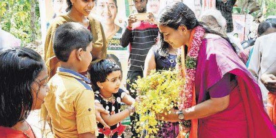 BJP candidate of Attingal Shobha Surendran greets children with 'kani konna'