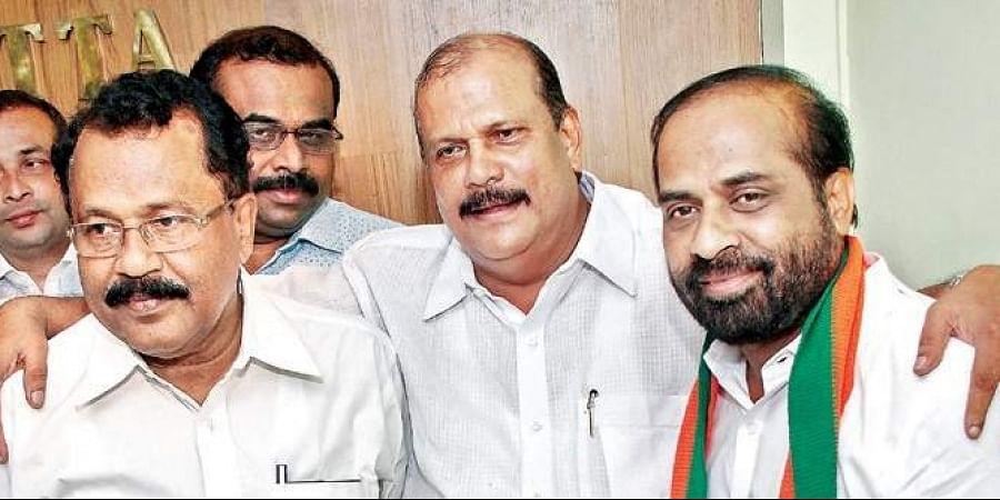 Janapaksham leader PC George MLA, after joining the NDA, with BJP state president P S Sreedharan Pillai and BJP national secretary Y Satya Kumar