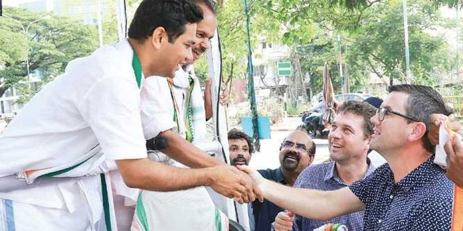 Nick Wakeling and Brad Battin, Aussie political leaders, at UDF Ernakulam candidate Hibi Eden's election campaign in Kochi on Wednesday