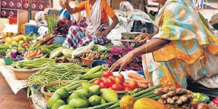 Vendors selling vegetables at the Palayam Market