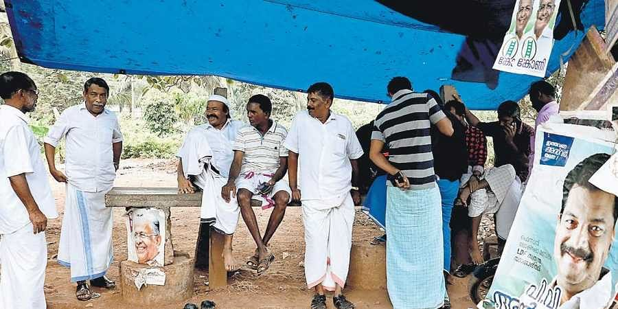 People gathered near a tea shop at Vettichira along national highway in Malappuram discussing elections