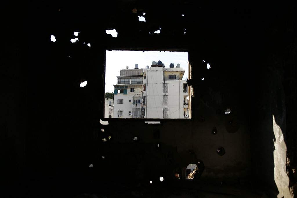 In this Nov. 17, 2018, photo, Shiyah, a Muslim Shiite neighborhood is seen from a destroyed apartment in the southern Beirut Christian district of Ain el-Rummaneh, Lebanon.