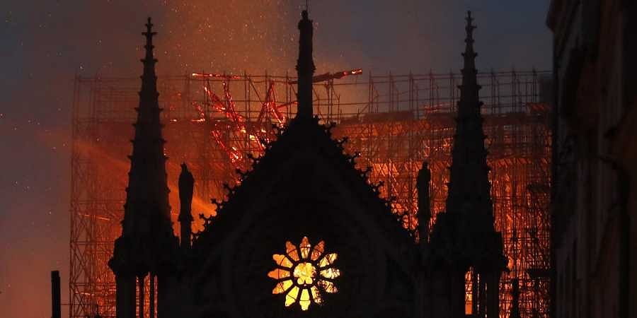 Flames and smoke rise from Notre Dame cathedral as it burns in Paris. (Photo | AP)