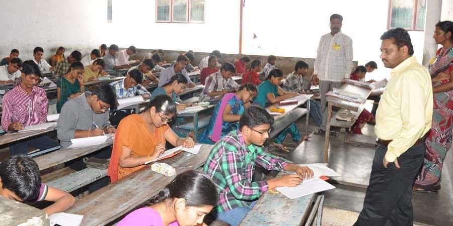 Intermediate exam students writing exam