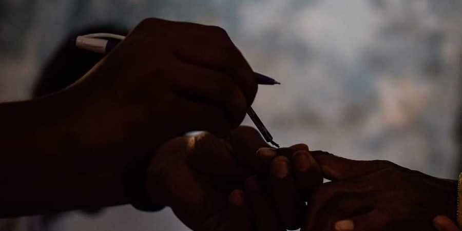 Voting, inked finger