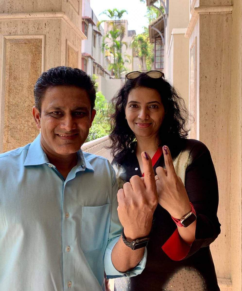 Cricketer Anil Kumble with his wife Chethana Ramatheertha  in Bengaluru after voting. (Photo | EPS)