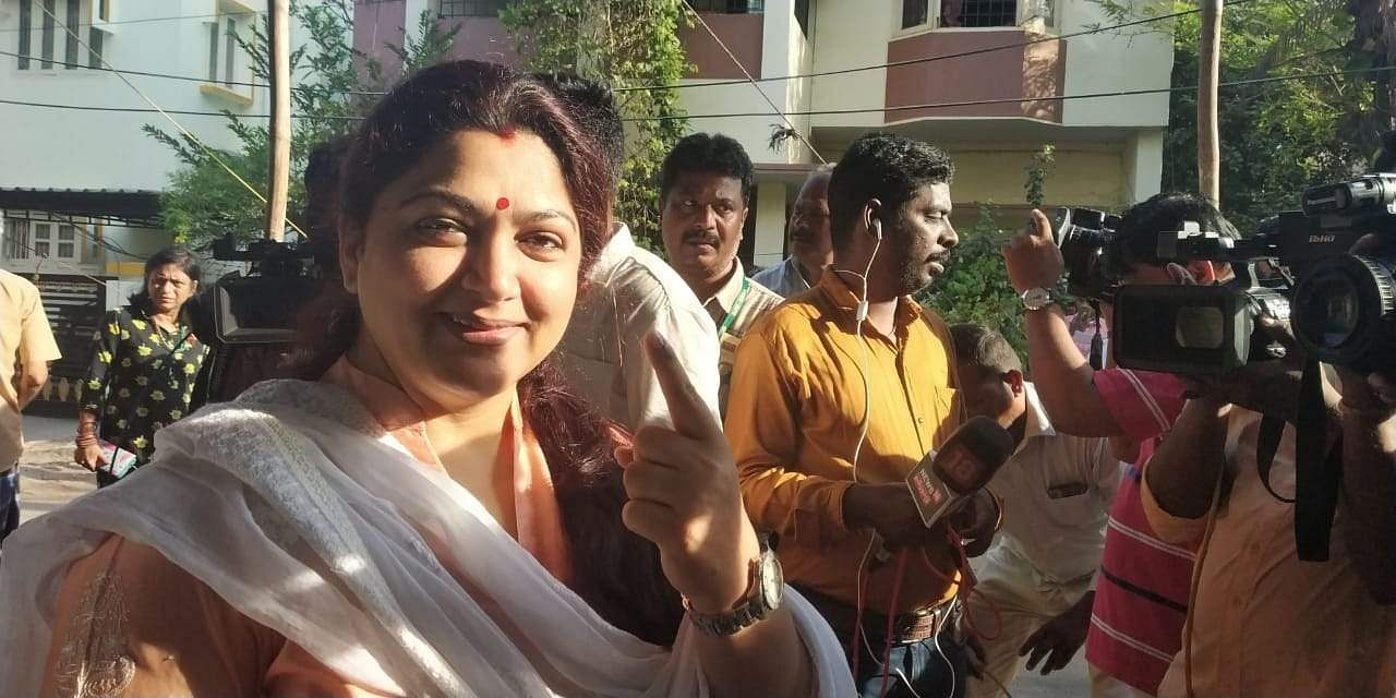Congress leader and actor Khushbu Sundar stands in a queue to cast her vote in Chennai.