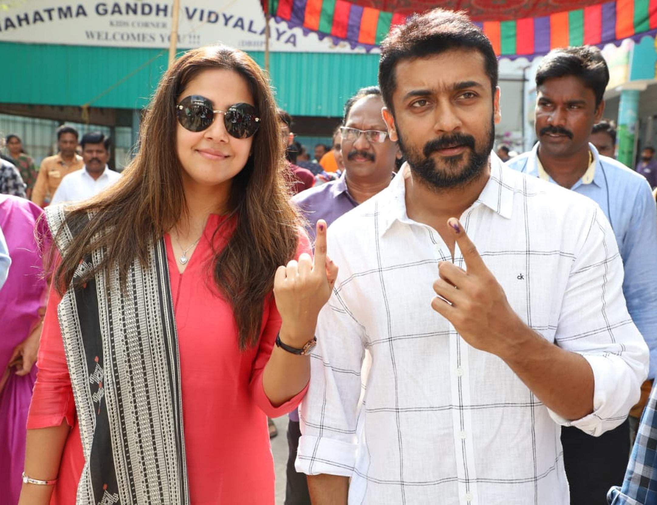 Actor-couple Suriya and Jyothika pose for photos after casting their votes in Chennai. (Photo | EPS)