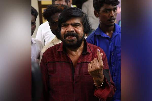 Actor and director T Rajendar cast his vote in T Nagar, Chennai. (Photo | EPS)