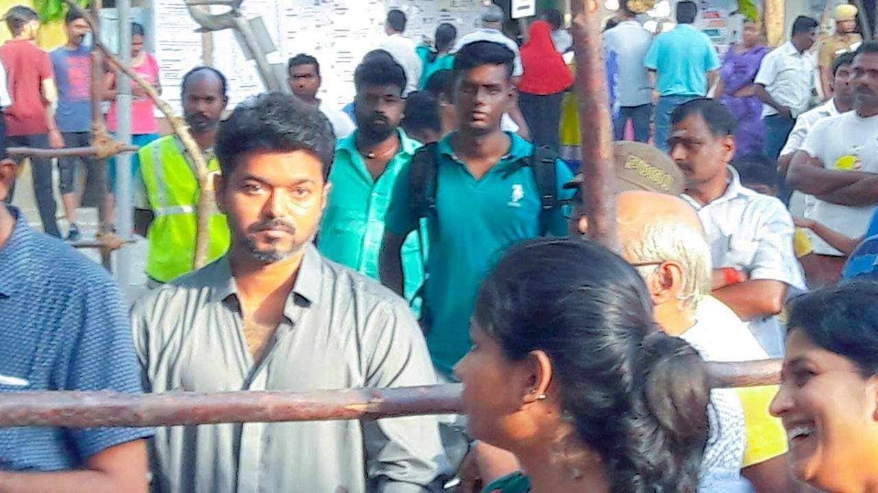Tamil actor Vijay waits for his turn at a polling booth in Saligramam, Chennai.