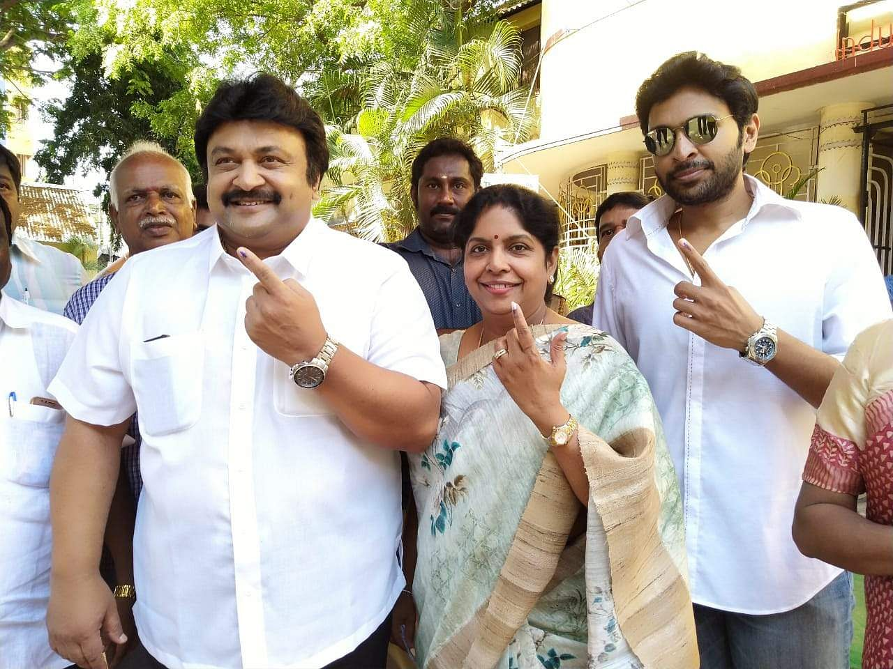 Actor Prabhu with his wife Punitha Prabhu and son Vikram Prabhu posing after casting their vote. (Photo | EPS)