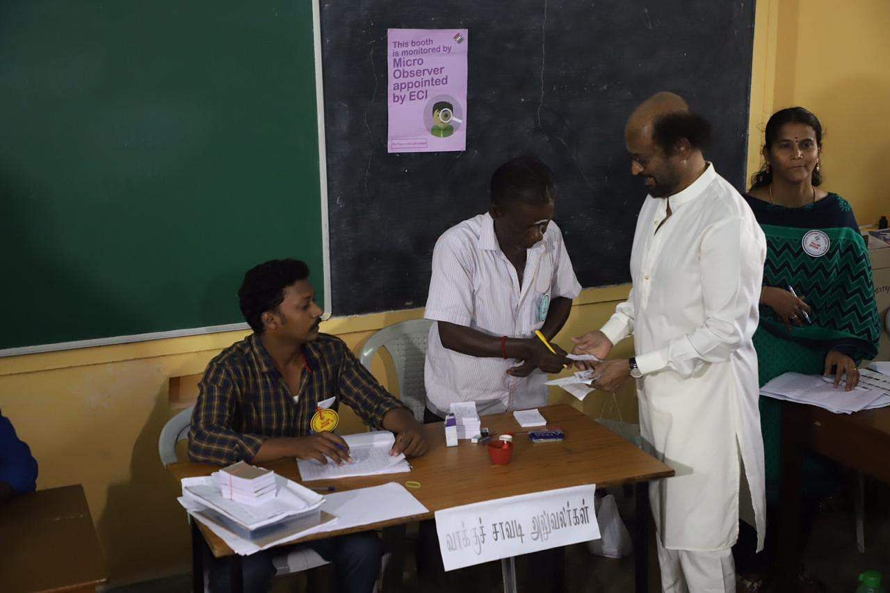 Actor-turned-politician Rajinikanth casting his vote at Stella Maris College, Chennai. (Photo | EPS)
