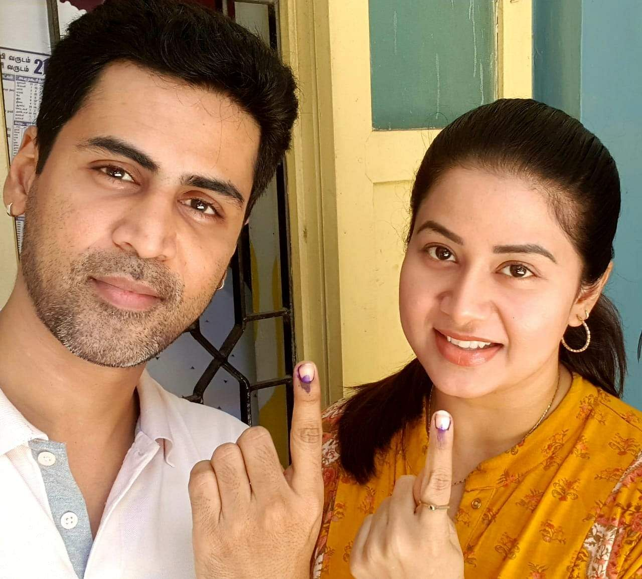 Singer Krish and his actor-wife Sangeetha show their inked fingers after casting their votes.