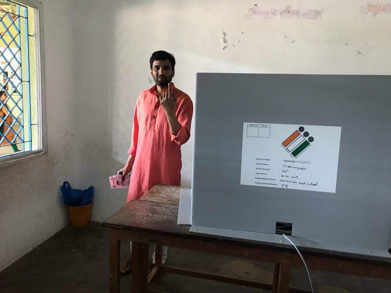 Tamil actor and comedian Santhanam in the polling booth after casting his vote.