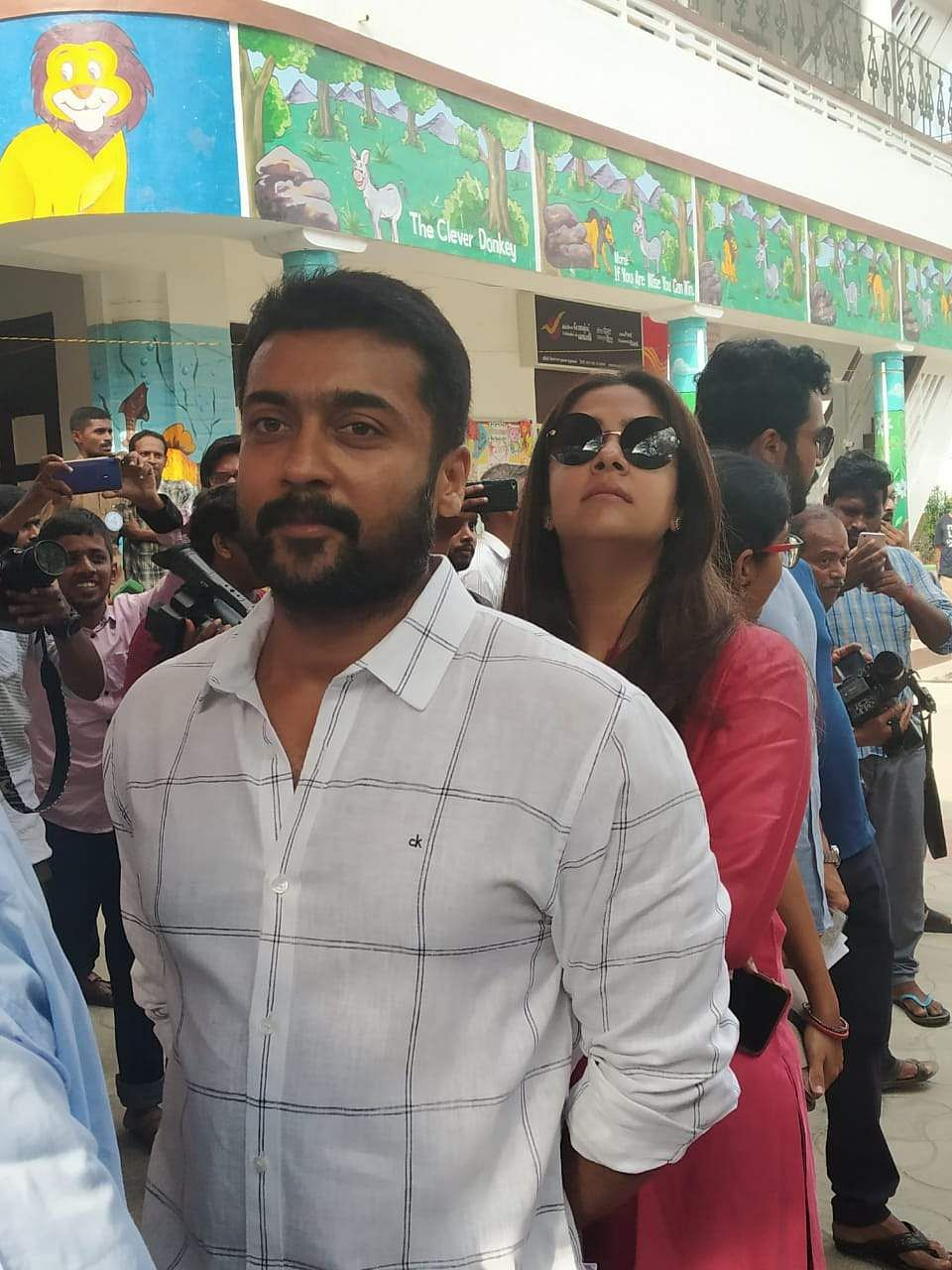 Actor Suriya and wife Jyothika standing in queue to cast their votes. (Photo | EPS)