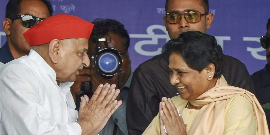 BSP chief Mayawati greets Samajwadi Party patriarch Mulayam Singh Yadav at a rally in his constituency, Mainpuri | PTI