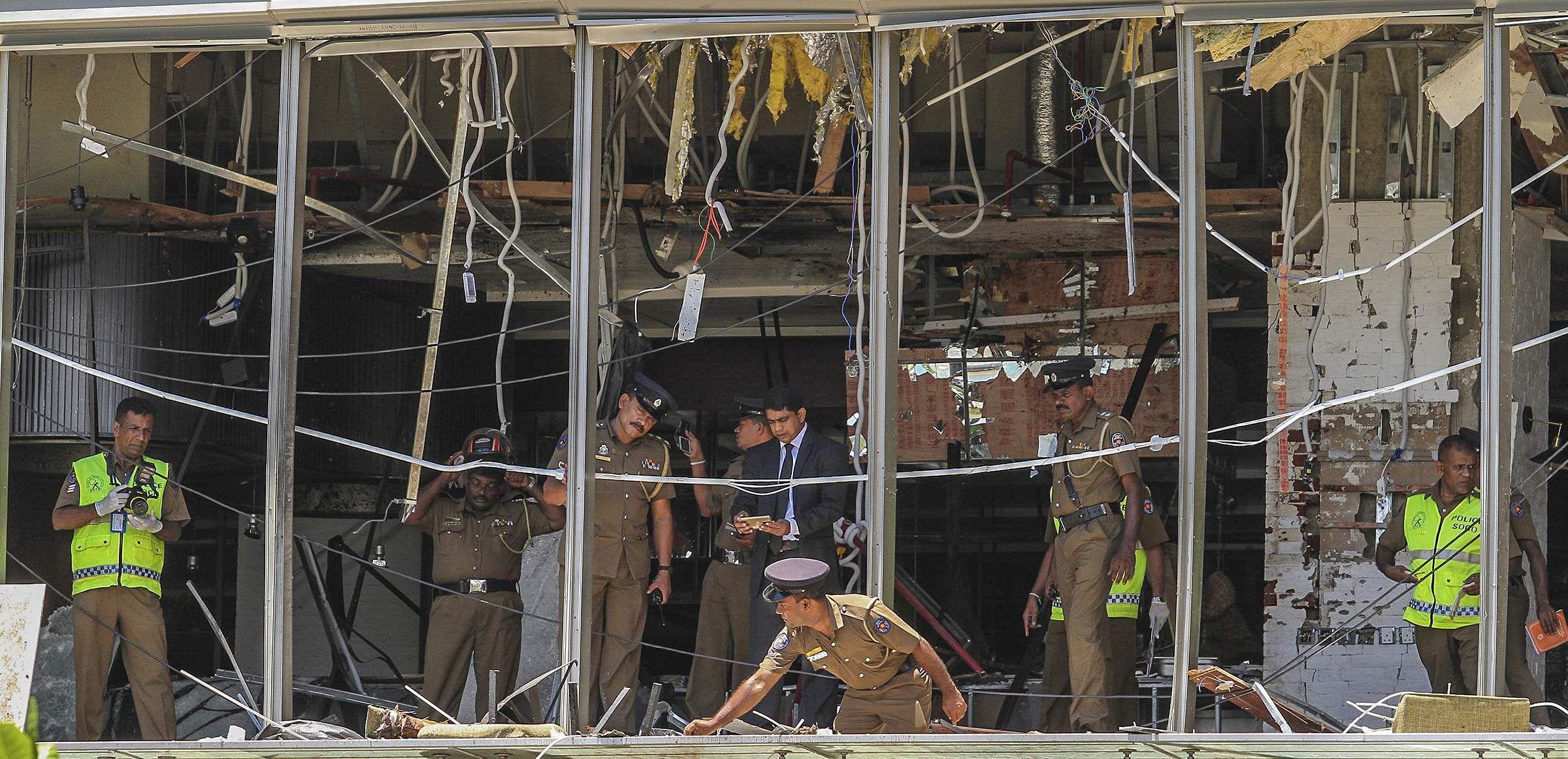 A Sri Lankan Police officer inspects a blast spot at the Shangri-la hotel in Colombo, Sri Lanka.