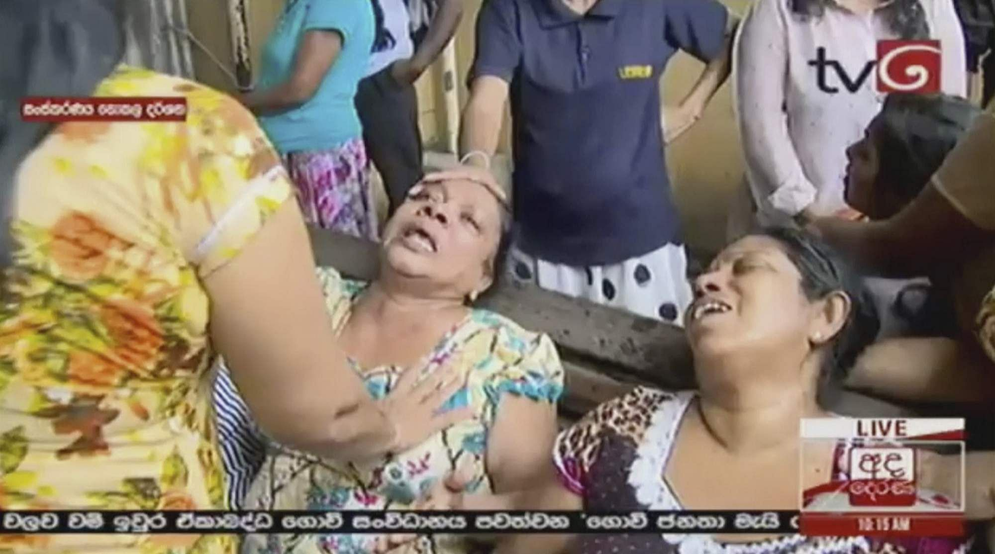 This image made from video, released by Derena TV shows women in despair after an explosion in Colombo, Sri Lanka.