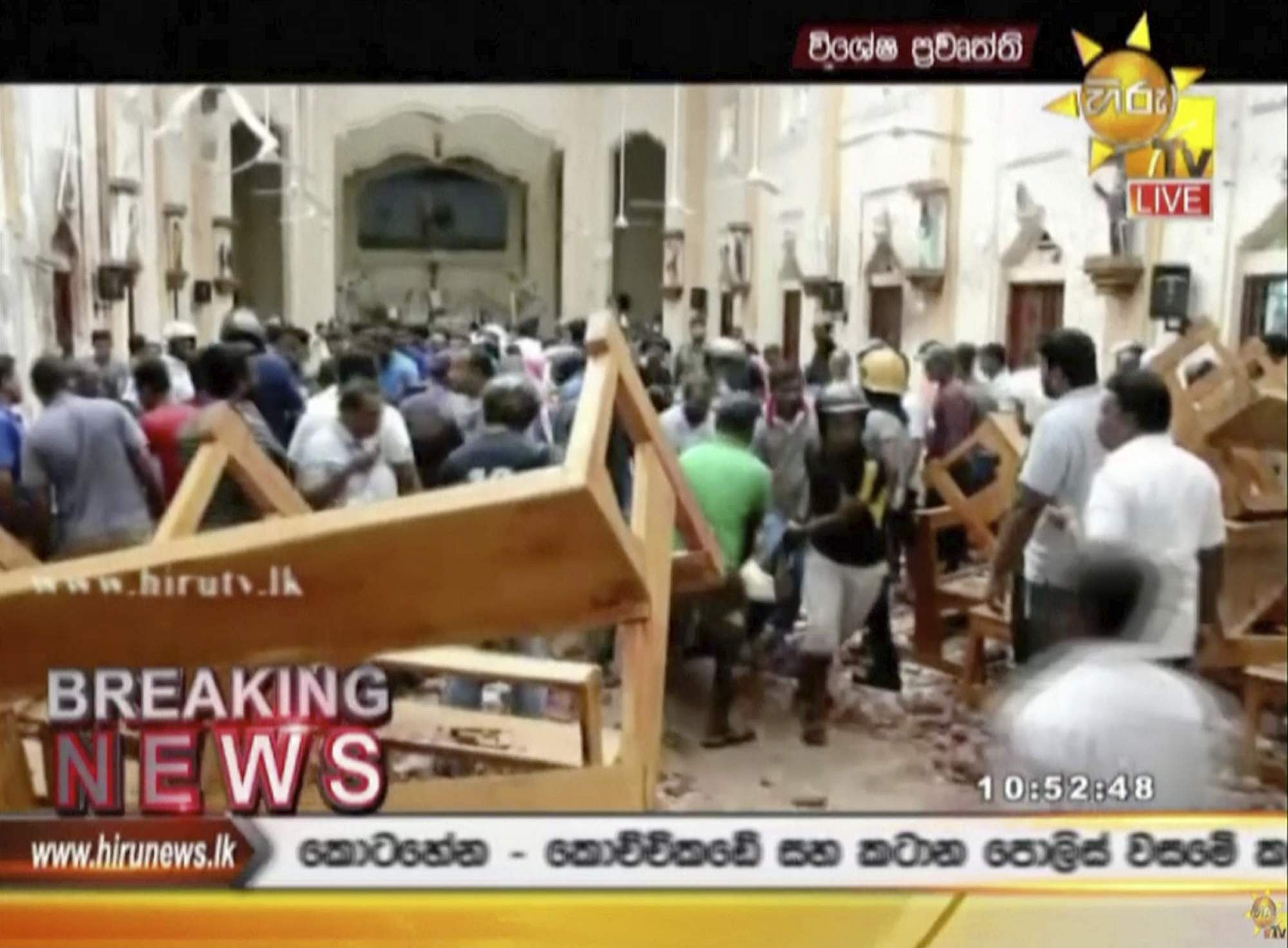 This image made from video provided by Hiru TV shows damage inside St. Anthony's Shrine after a blast in Colombo, Sri Lanka.