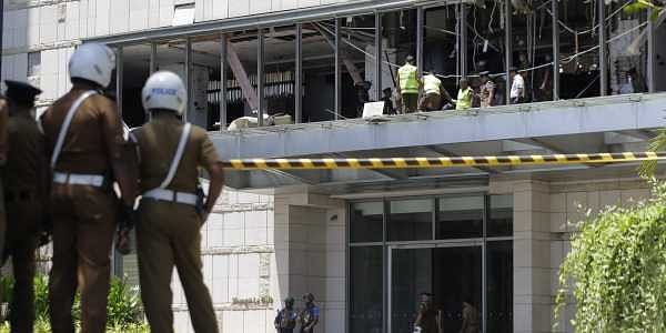 Police and forensic officials inspect a blast spot at the Shangri-la hotel in Colombo, Sri Lanka, on Sunday. (Photo | AP)