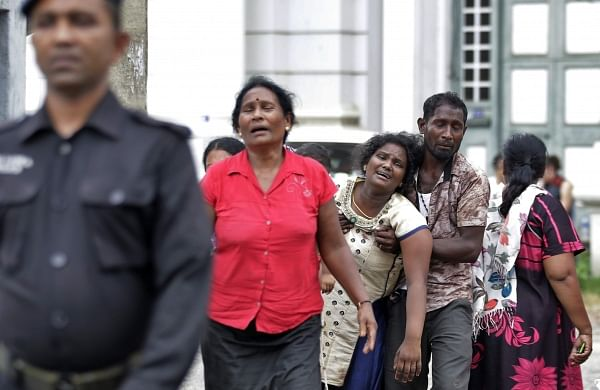 Relatives of a blast victim grieve outside a morgue in Colombo, Sri Lanka. (Photo | AP)