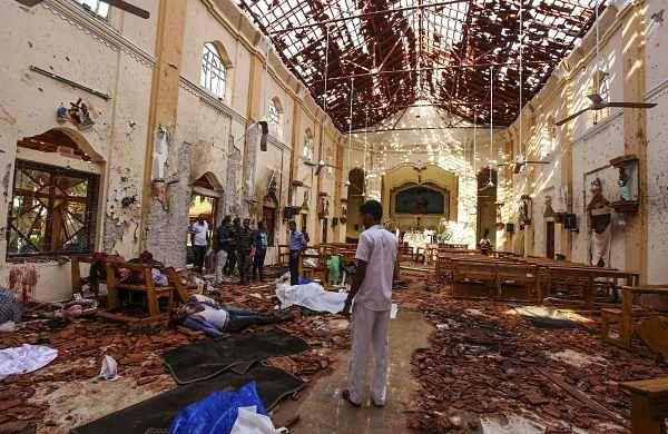 Dead bodies of victims lie inside St. Sebastian's Church damaged in blast in Negombo, north of Colombo, Sri Lanka. (Photo | AP)