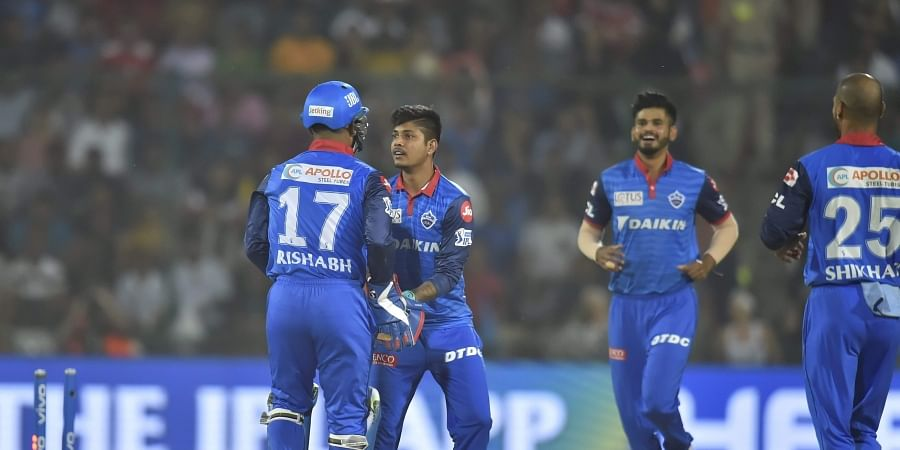 DC bowler Sandeep Lamichhane celebrates the wicket of KXIP Batsman K L Rahul with his teammates. (Photo | PTI)