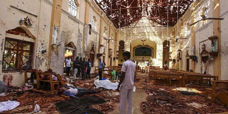 Dead bodies of victims lie inside St. Sebastian's Church damaged in blast in Negombo, north of Colombo, Sri Lanka.