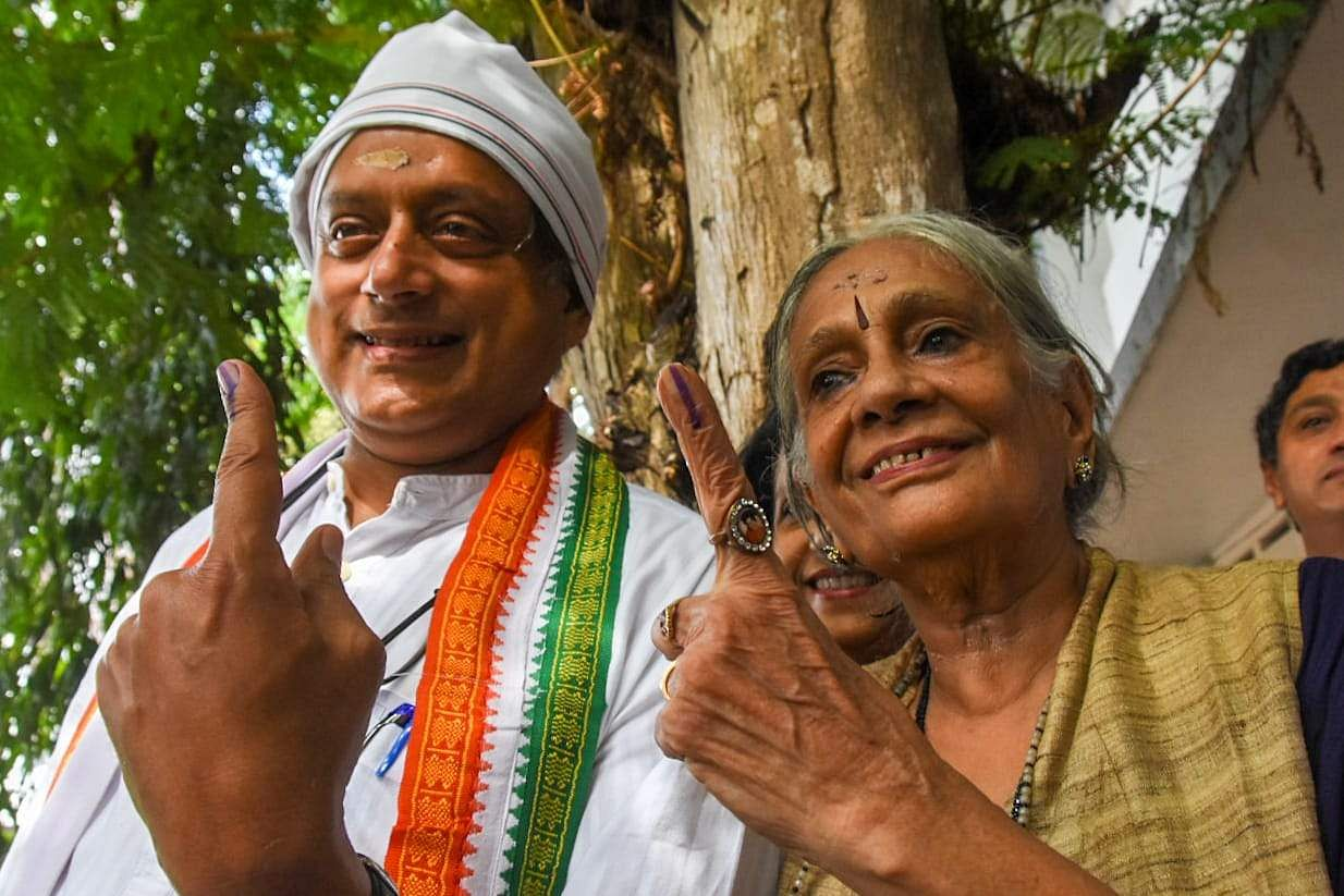 UDF candidate for Thiruvananthapuram Shashi Tharoor and his mother Lily Tharoor pose for a photo after casting their votes at the Government Girls Higher Secondary School, Cotton Hill in Thiruvananthapuram. (Photo | BP Deepu, EPS)