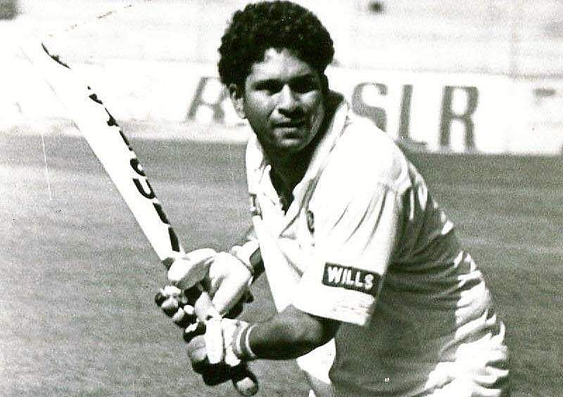 Sachin Tendulkar swinging the bat during a practice session.
