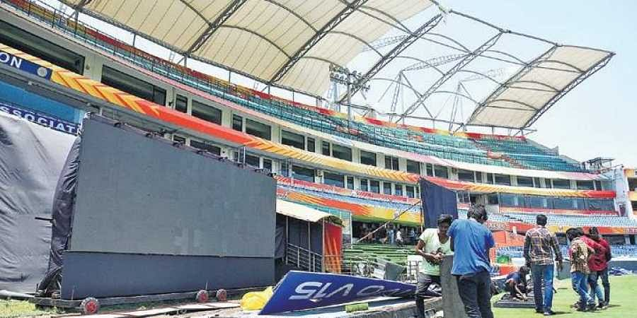 Work in progress to repair the damaged South Terrace Pavilion canopy at Rajiv Gandhi International Cricket Stadium in Hyderabad on Tuesday | S Senbagapandiyan