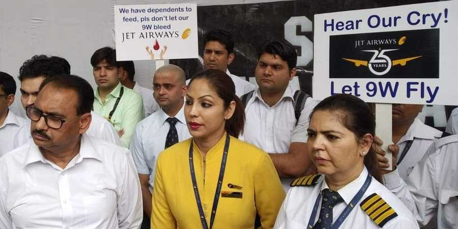 Jet Airways employees stage a protest over delay in their salaries at jantar mantar in New Delhi