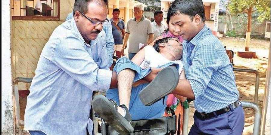 A physically challenged voter being taken by his relatives  to a polling booth in Bhubaneswar on Tuesday