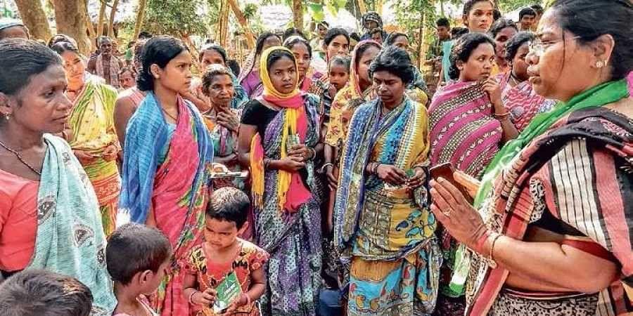 JMM Lok Sabha candidate Anjani Soren speaking to tribals at Kamarjanta village in Mayurbhanj district