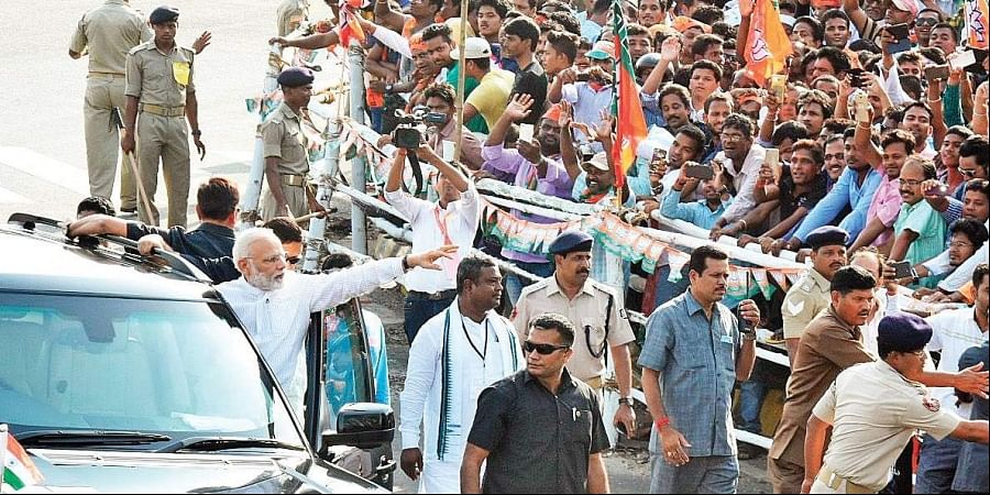 Prime Minister Narendra Modi waves to the crowd during his road show. (File Photo  Express)