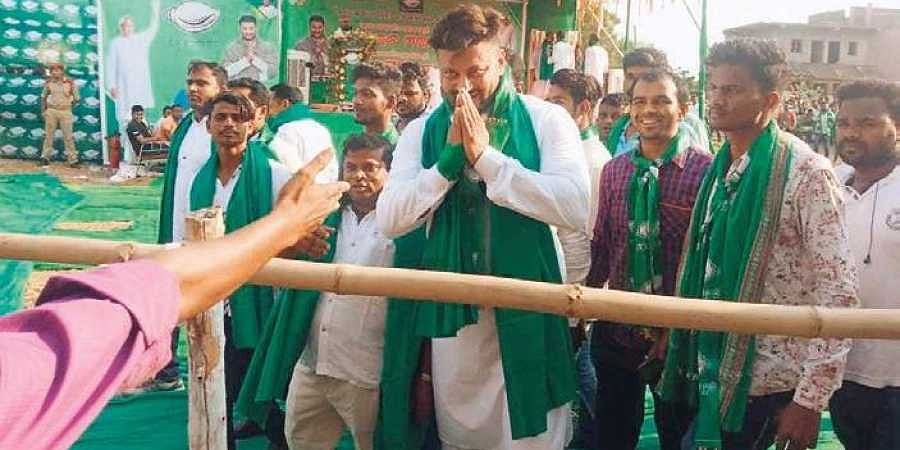 BJD MP candidate Anubhav Mohanty greeting people at an election meeting