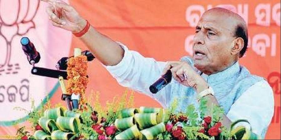 Rajnath Singh addressing an election meeting at Chandabali in Bhadrak on Thursday